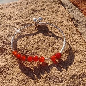 Silver and red beads glass beads bracelet I think